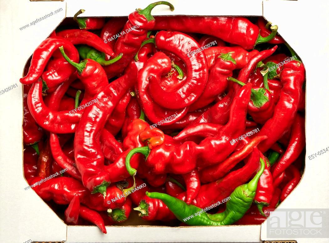 Stock Photo: ripe red hot pepper in a white cardboard box, top view.