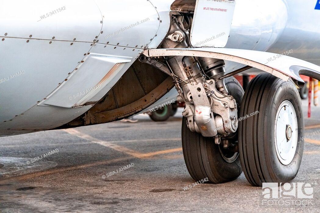 Stock Photo: Kahmandu, Nepal - October 5 2019: Tyre of a small plane.