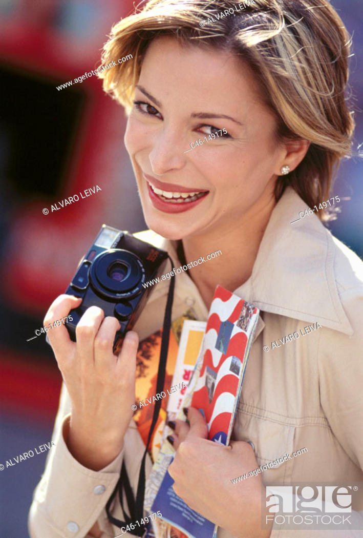 Stock Photo: Woman with camera.