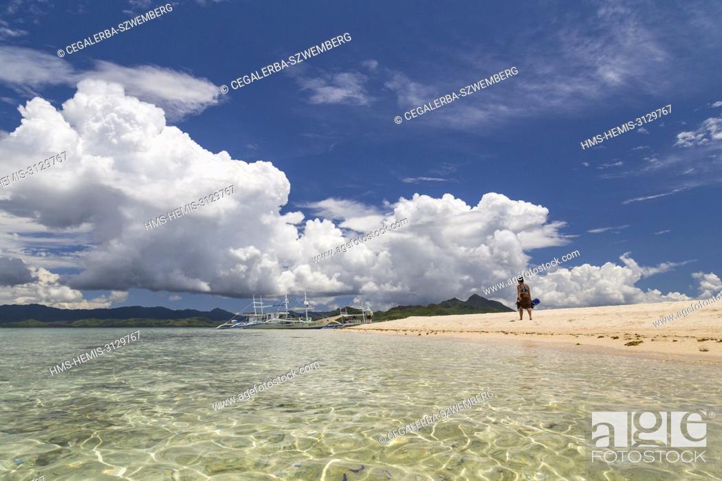 Stock Photo: Philippines, Palawan, Taytay Bay, Isla Blanca, woman walking on the sand beach.