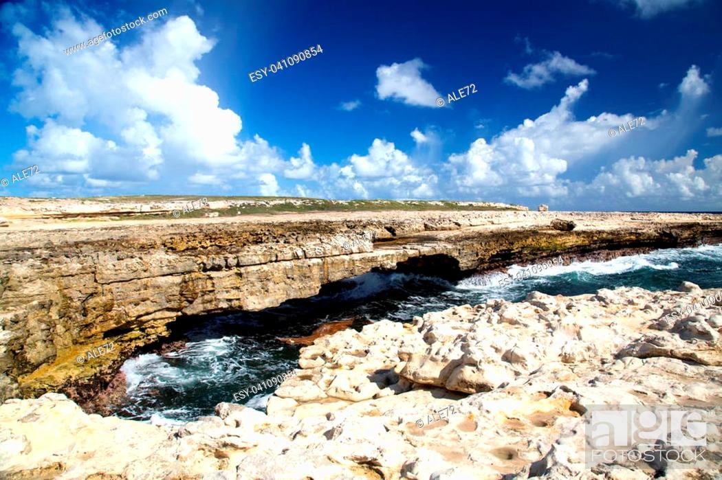 Stock Photo: Antigua, rocky shores and big waves at the Devil's Bridge.