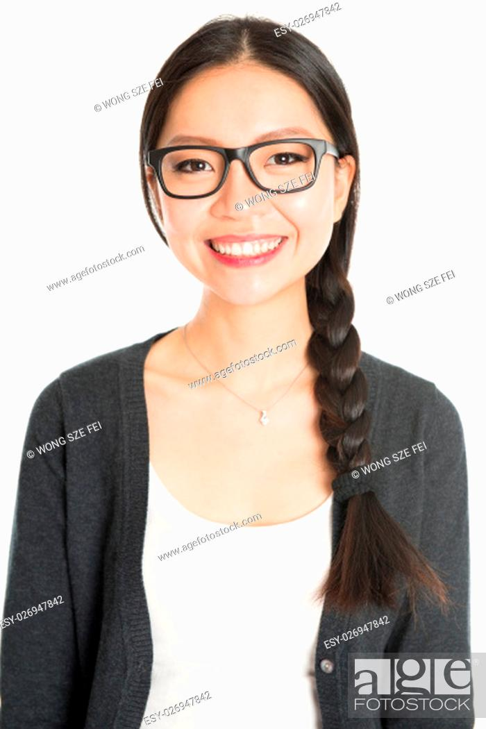 Stock Photo: Portrait of young Asian girl with braid hair is smiling, isolated on white background.