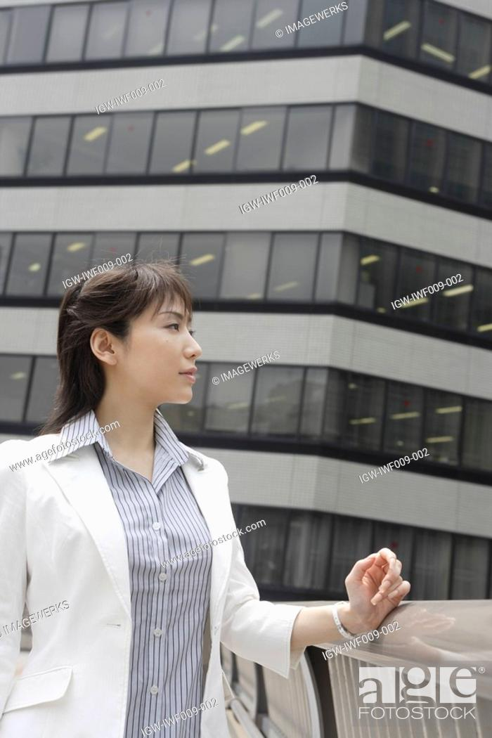 Stock Photo: A woman staring at something during daylight.