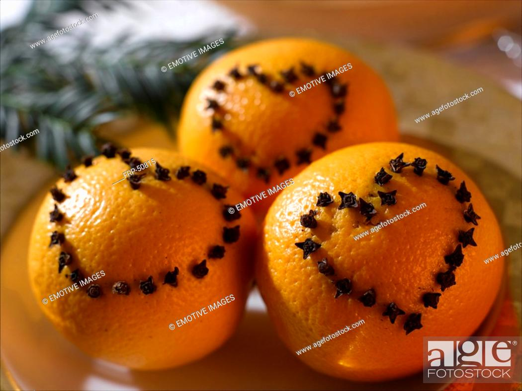 Stock Photo: Oranges with a heart pattern made of cloves.