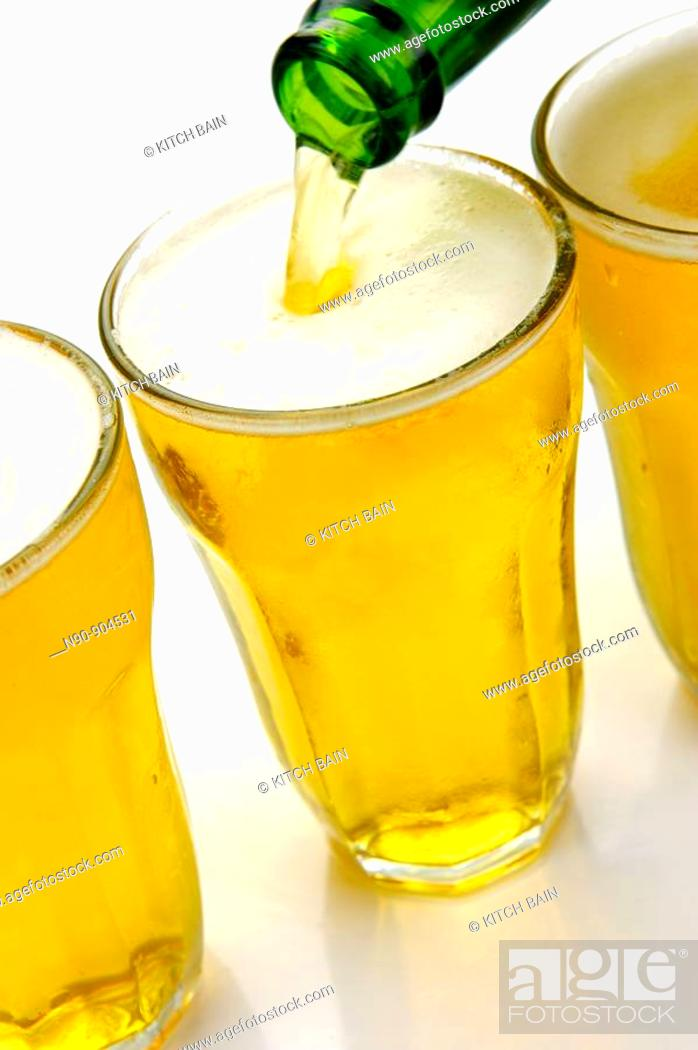 Stock Photo: Glasses of beer isolated against a white background.