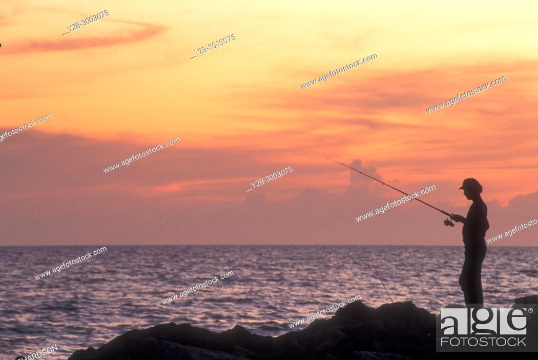 Stock Photo: Fisherman at Blind Pass Snibel Island Florida.