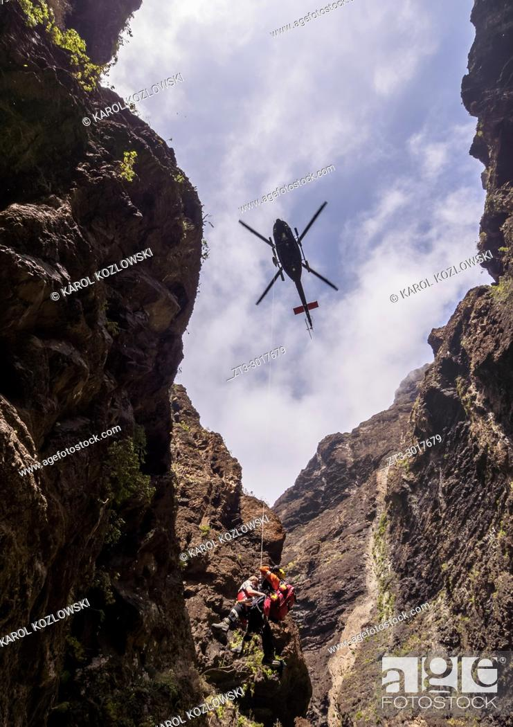 Stock Photo: Rescue Helicopter over Barranco de Masca, gorge, Teno Massif, Tenerife Island, Canary Islands, Spain.