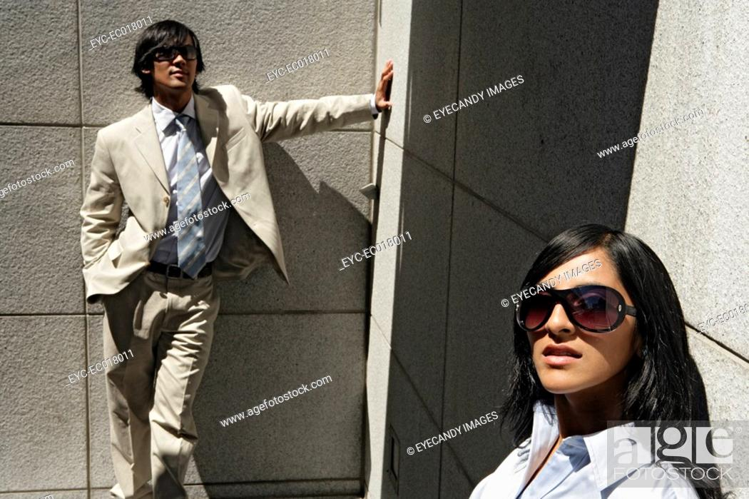 Stock Photo: View of two colleagues in professional attire.