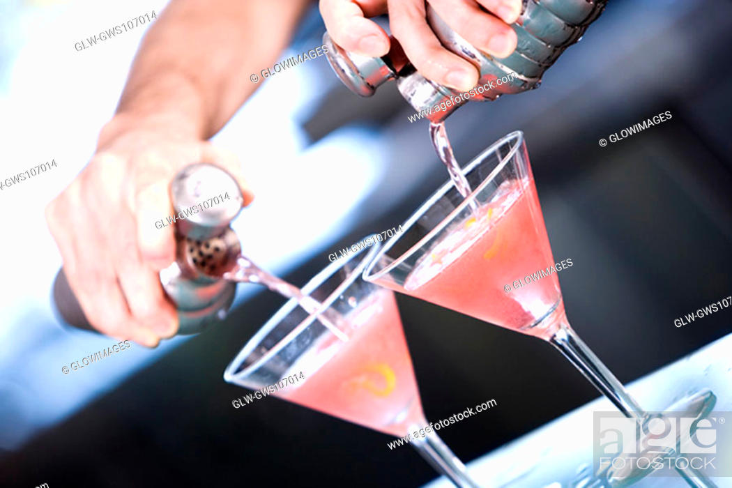 Stock Photo: Close-up of a person's hand preparing a cocktail.