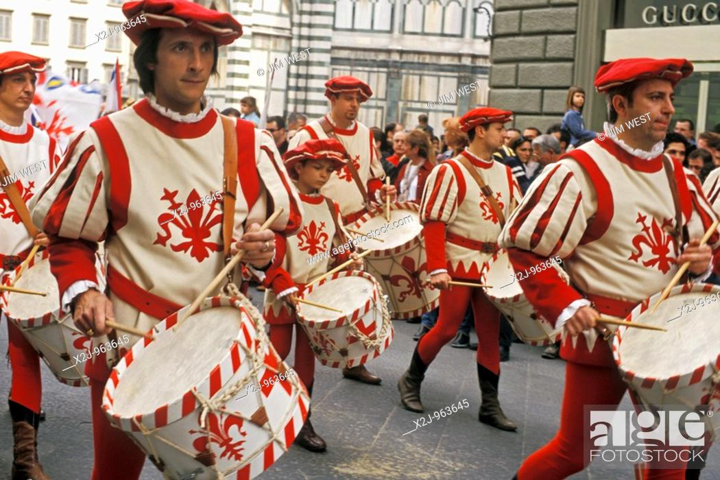 Stock Photo: Florence, Italy - Residents wearing medieval costumes parade through the streets on Easter Sunday after the Scoppio del Carro pageant at the cathedral, or Duomo.