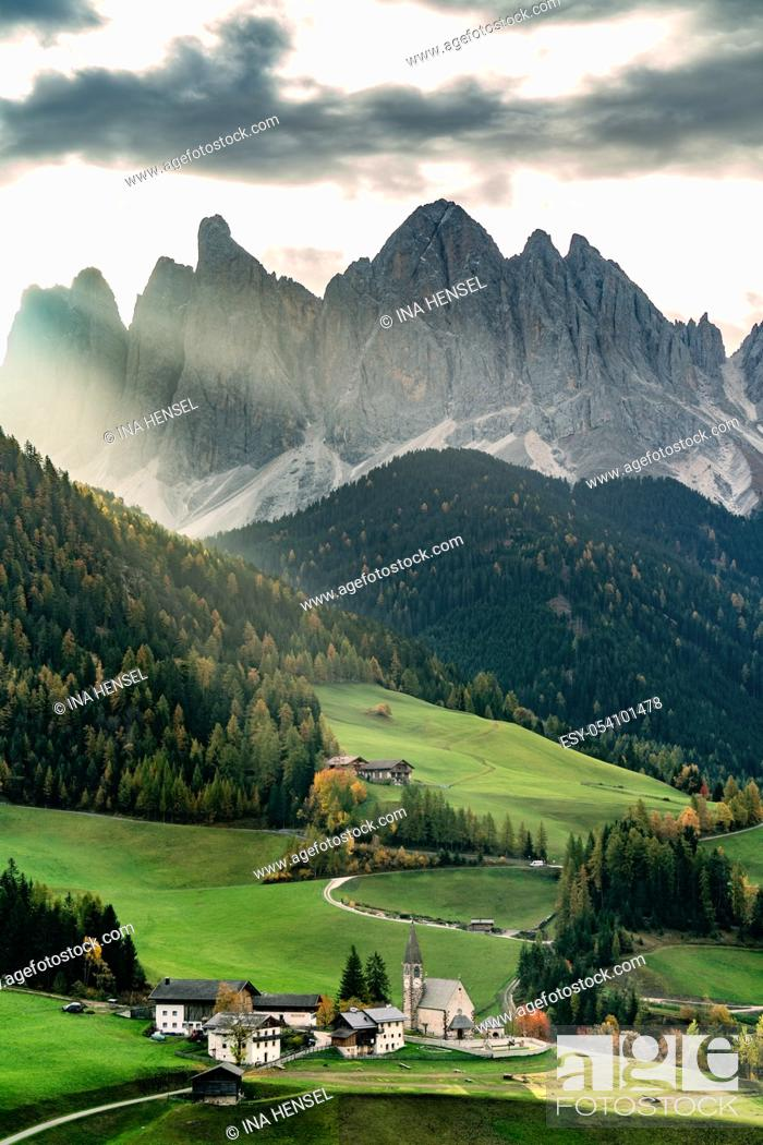 Stock Photo: Sunrise at the famous church St. Magdalena in Santa Maddalena in Villnoess valley, South Tyrol on a colourful autumn day.