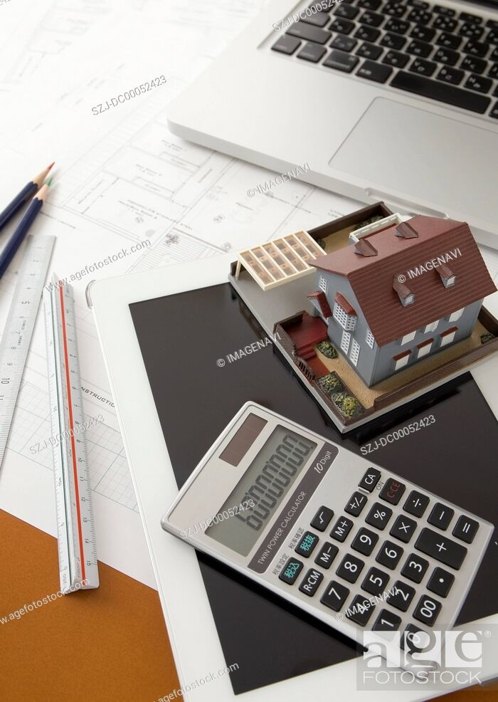 Stock Photo: Architectural model, a calculator, and a tablet PC.