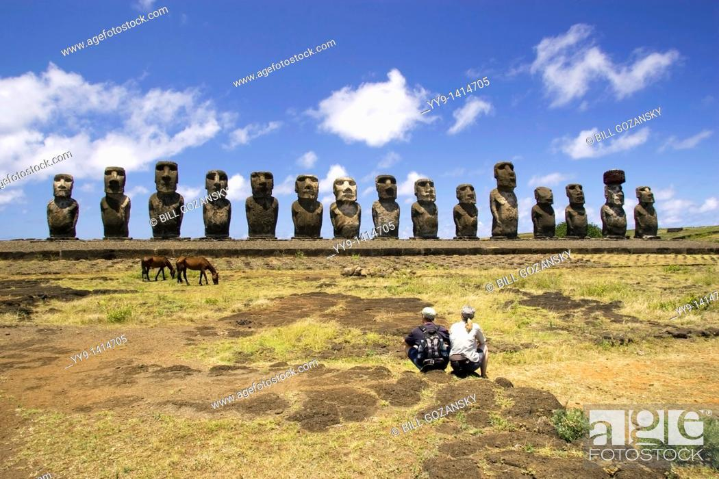Stock Photo: Couple sitting at Ahu Tongariki Moai - Easter Island, Chile.