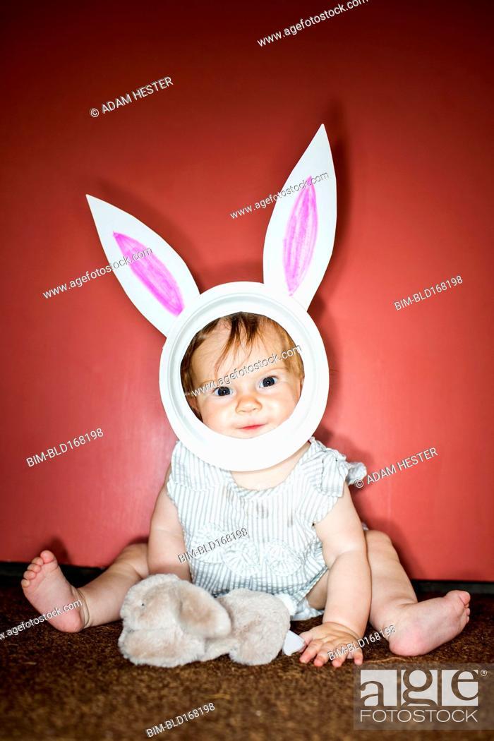 Stock Photo: Caucasian baby girl wearing Easter Bunny costume.