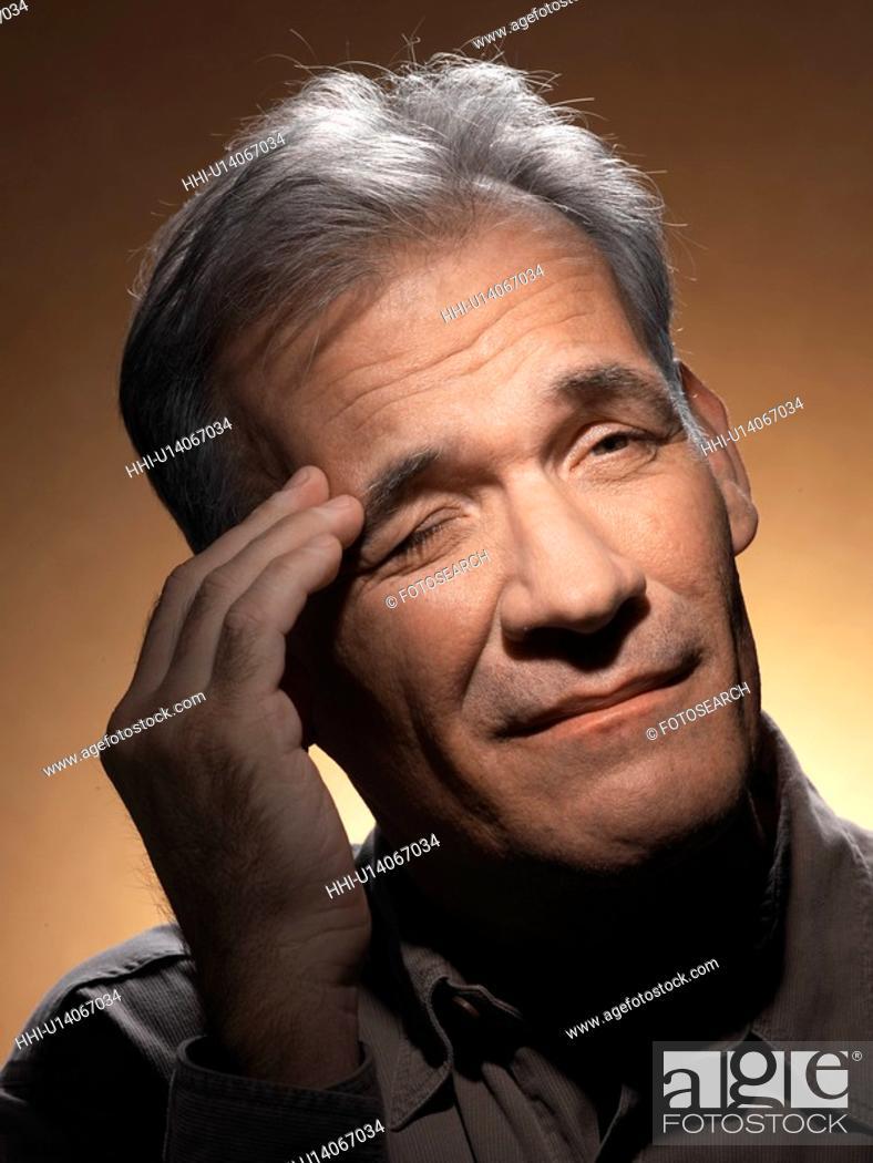 Stock Photo: Mature man with headache.