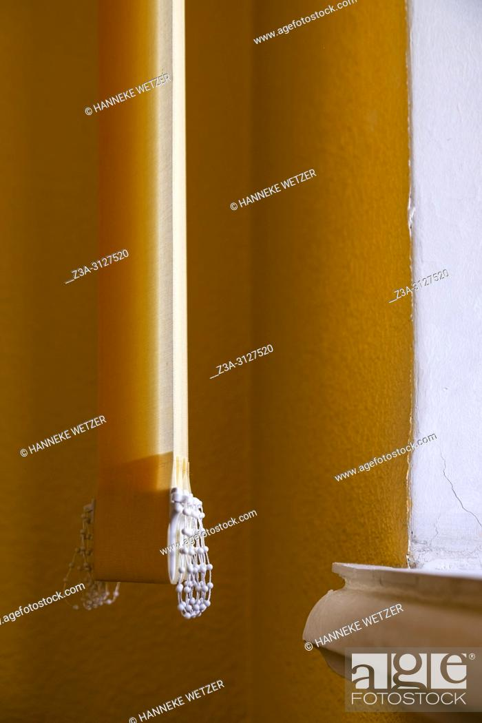Stock Photo: Orange vertical window blinds.