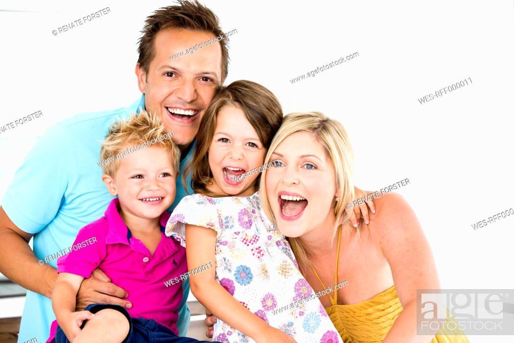 Stock Photo: Germany, Playful family, smiling, portrait.