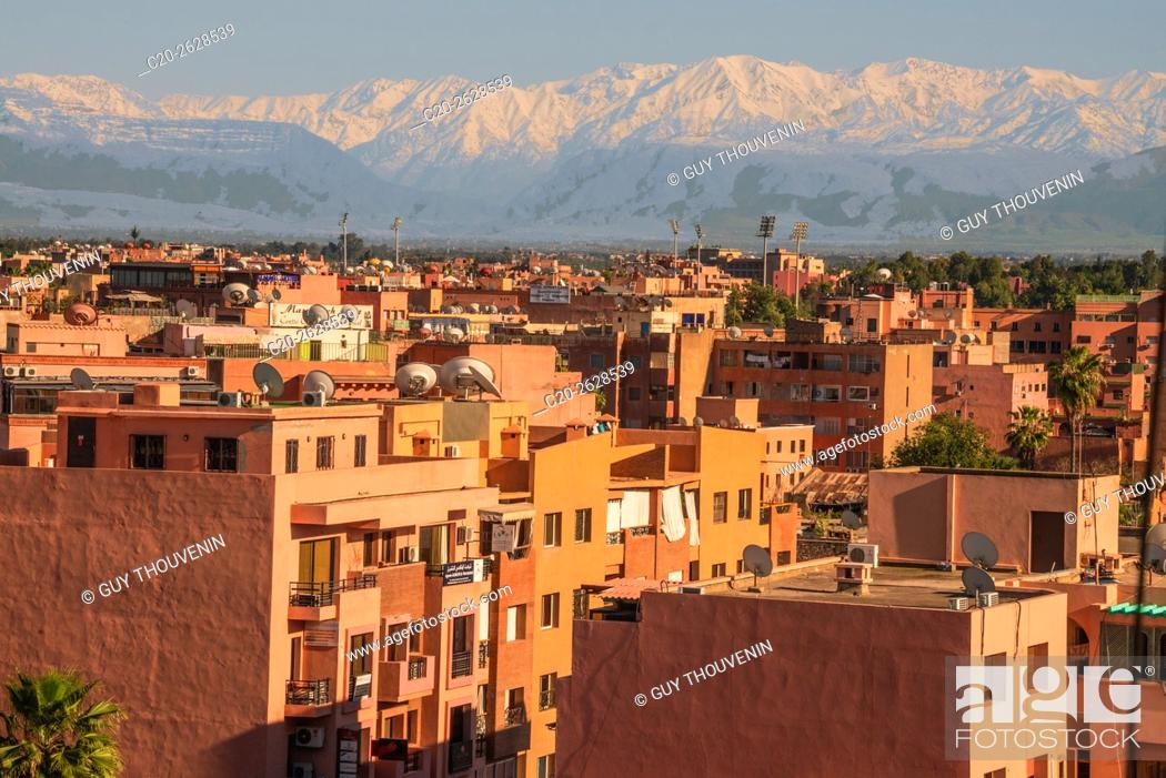 Stock Photo: Marrakech panorama, with Atlas mountain in the backgroud, Morocco.