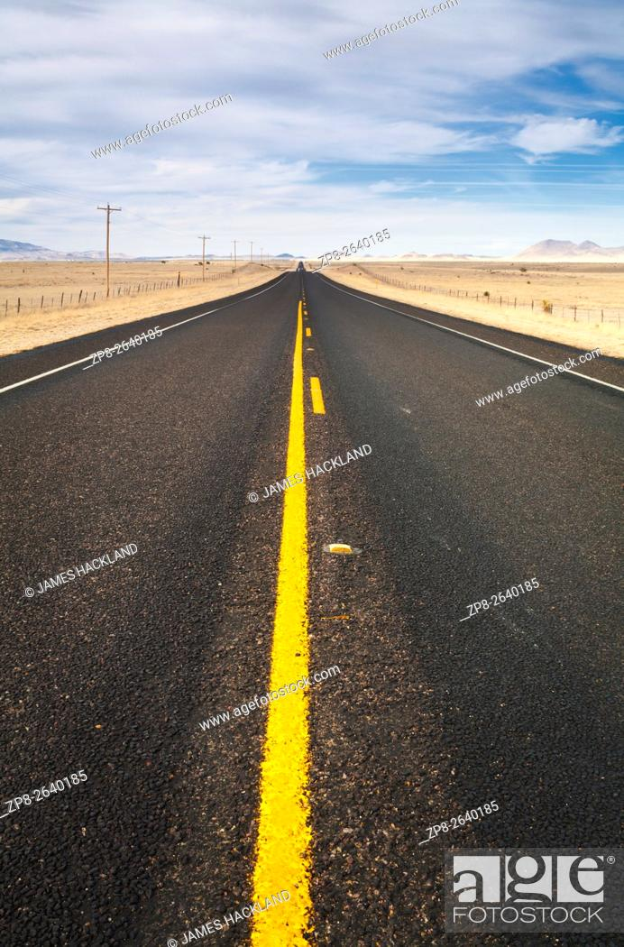 Stock Photo: A deserted two-lane highway north of Marfa. State Highway 17, Presidio County, Texas, USA.