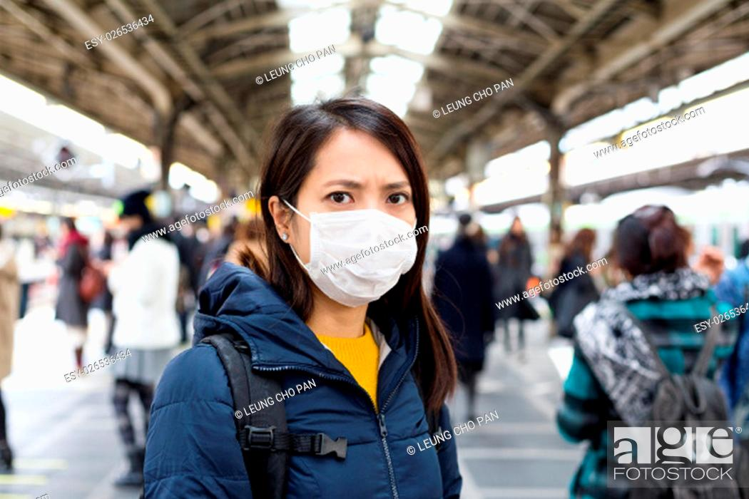 Stock Photo: Woman wearing face mask at outdoor.