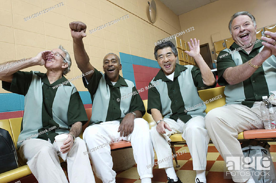 Stock Photo: Men cheering at bowling alley.