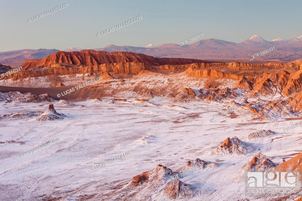Stock Photo: Valle de la Luna (Valley of the Moon ), in background Andes Mountains with snow on top , and salt deposited on the nearest mountains and ground, Atacama desert.