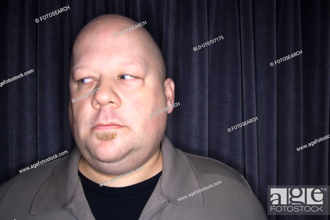 Stock Photo: Bald man looking to side.