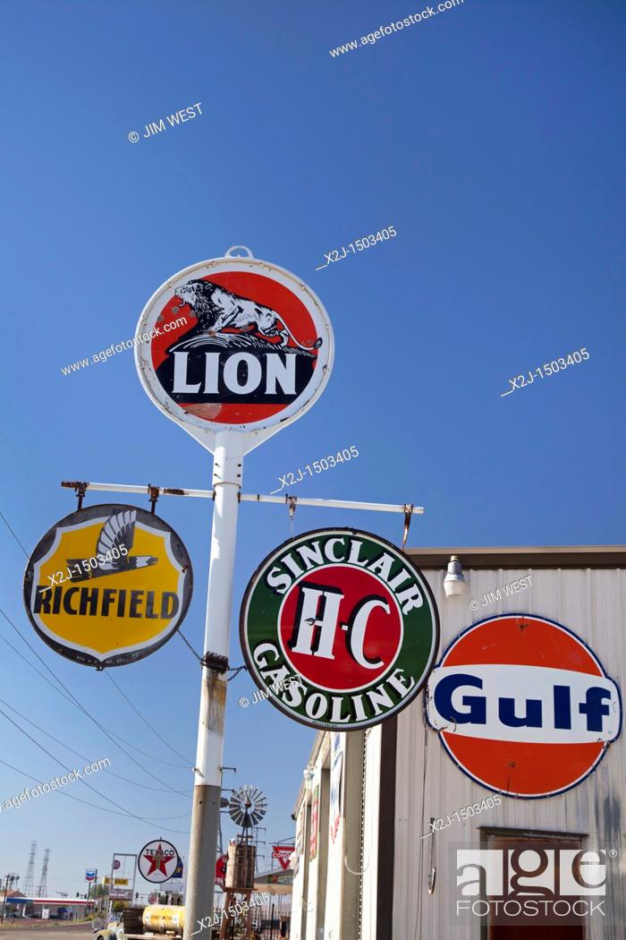 Stock Photo: Kramer Junction, California - Old gas station signs on display at an antique dealer in the Mojave Desert.