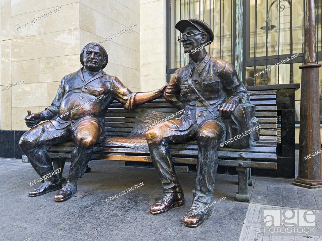 Stock Photo: Bronze sculpture Postman and his friend chatting on a bench, Shavteli street, Tbilisi, Georgia.