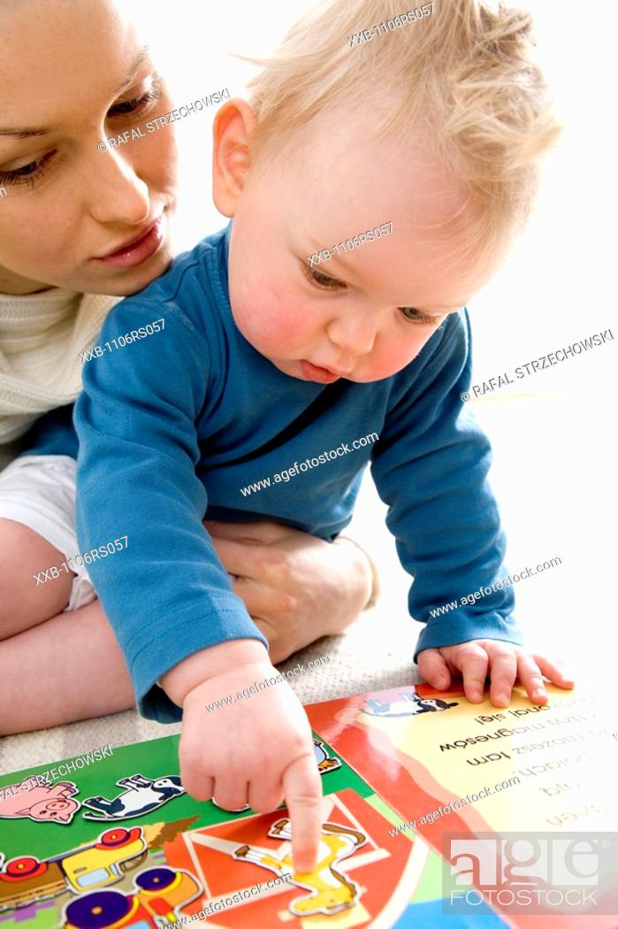 Stock Photo: mother playing with baby.