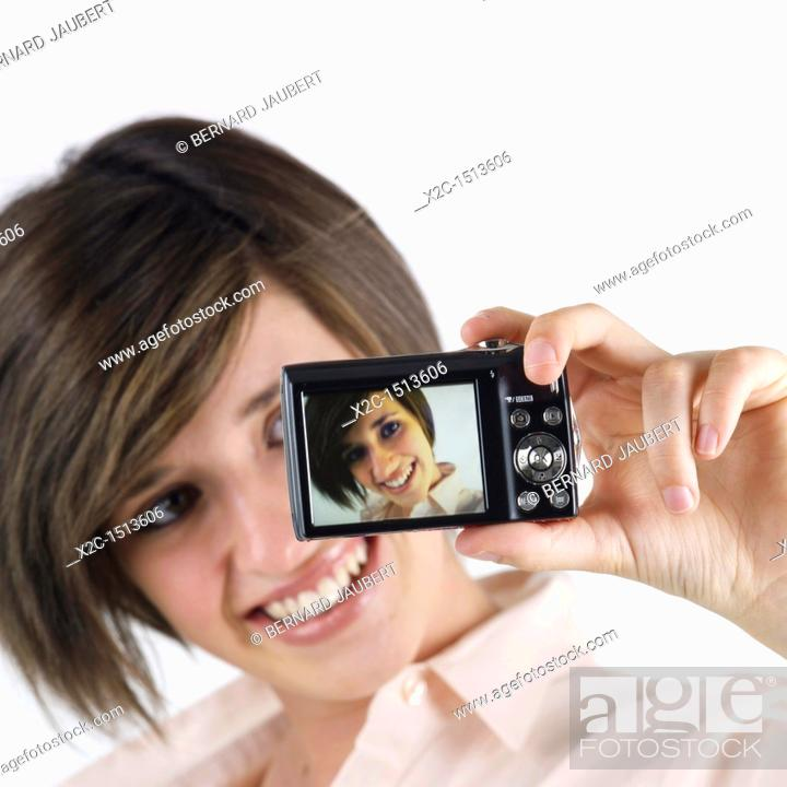Stock Photo: Woman taking picture with camera.