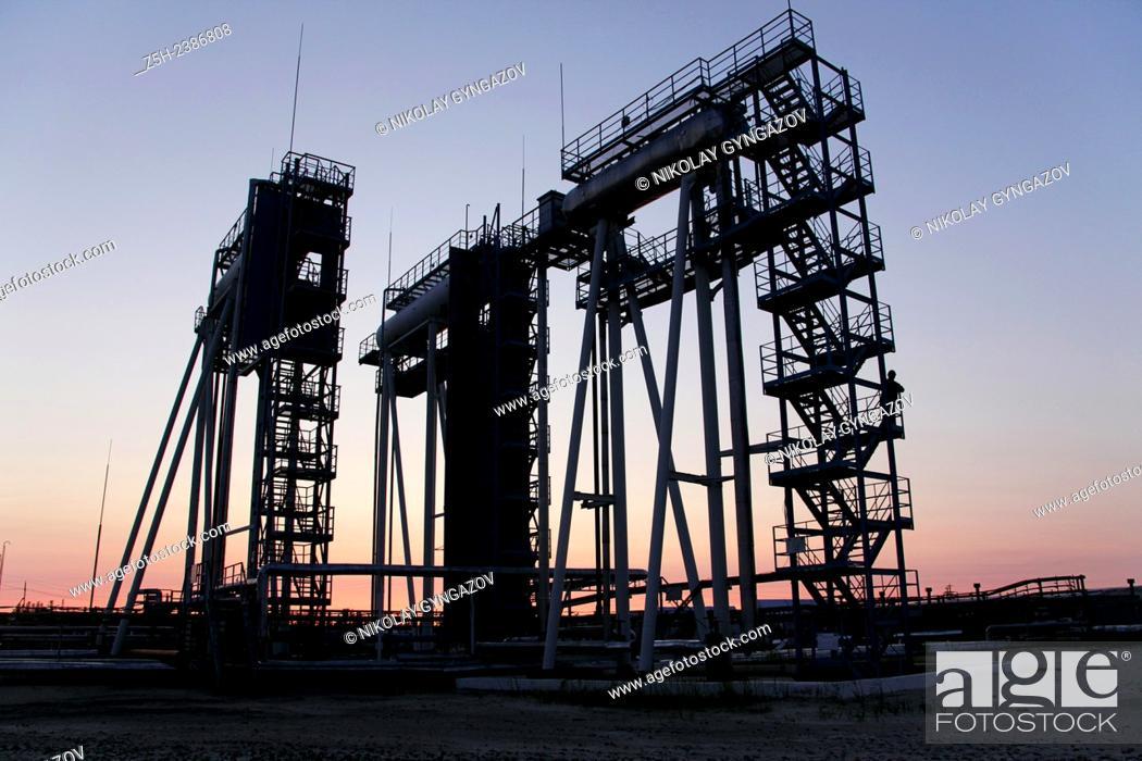 Stock Photo: Khanty-Mansi Autonomous Okrug-Yugra. Promising oil field in Siberia. Oil Tank Farm.
