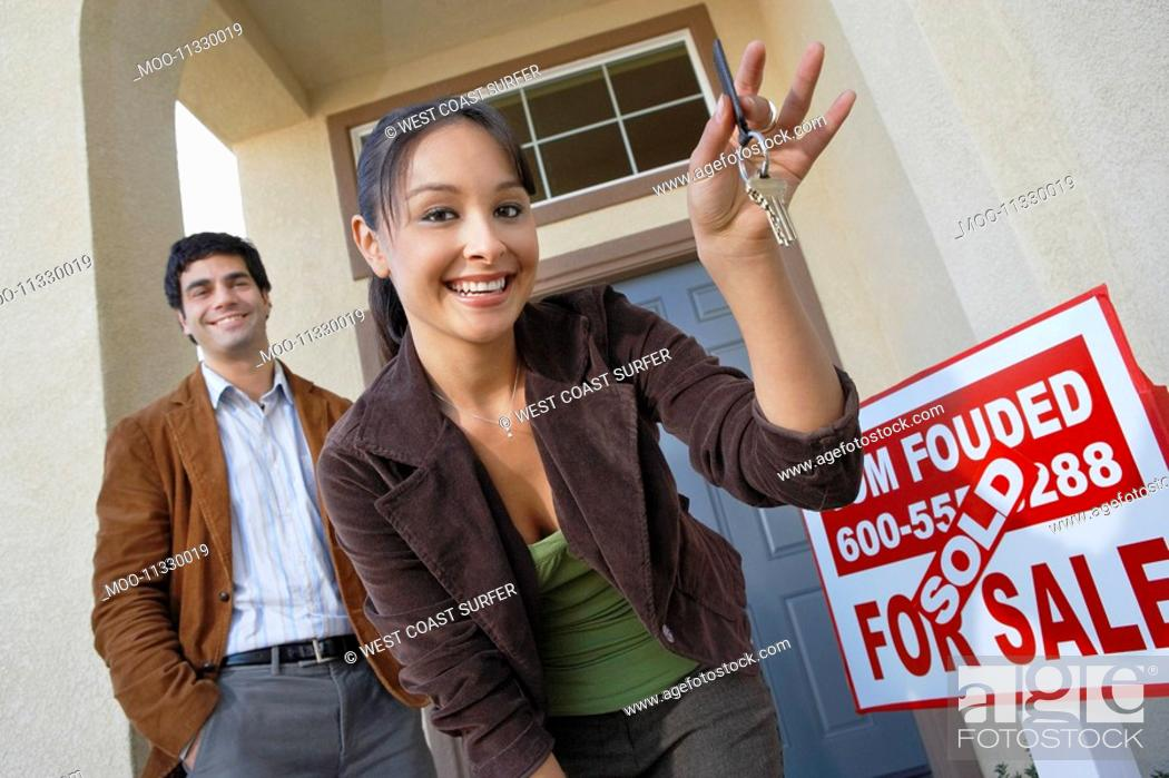 Stock Photo: Couple with keys to new home.