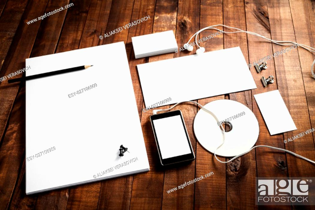 Stock Photo: Photo of blank paperwork template. Responsive design mock up on wooden table background. Template for branding identity. Stationery set.