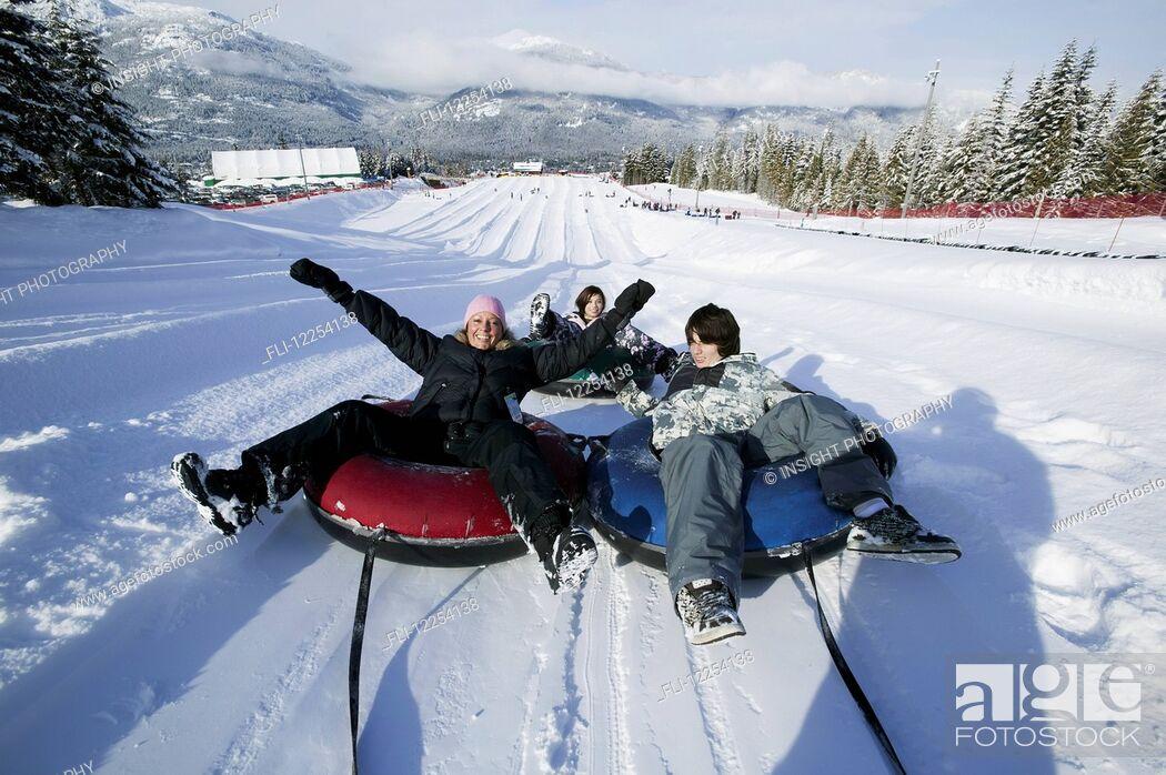 Stock Photo: Family fun at the Blackcomb Mountain tube park; Whistler, British Columbia, Canada.