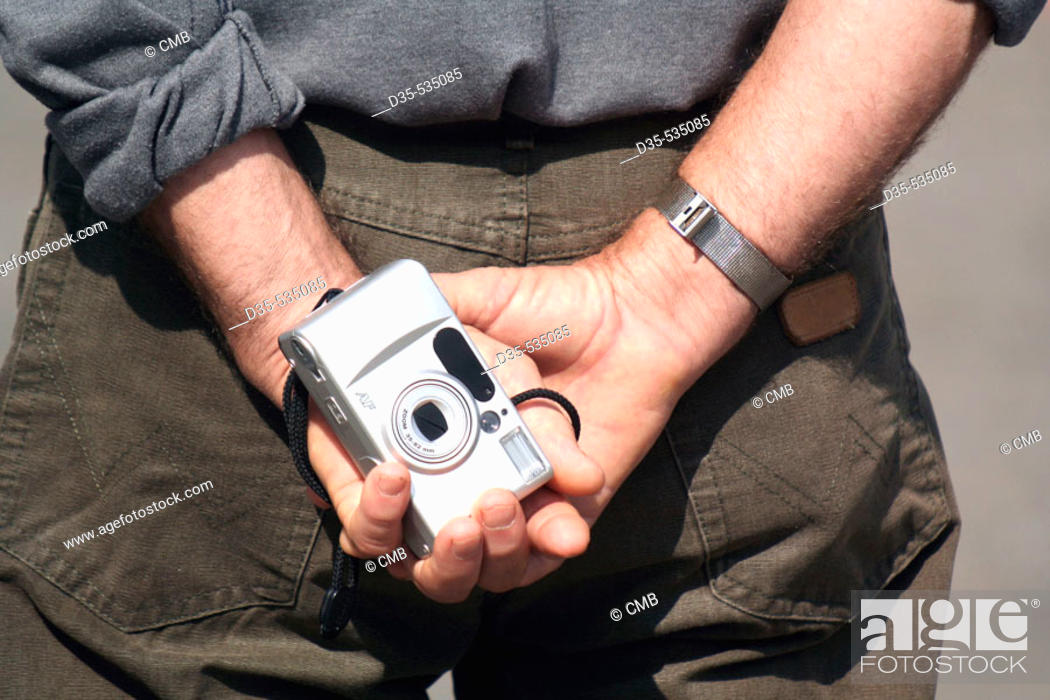 Stock Photo: Tourist holding camera in his hands.