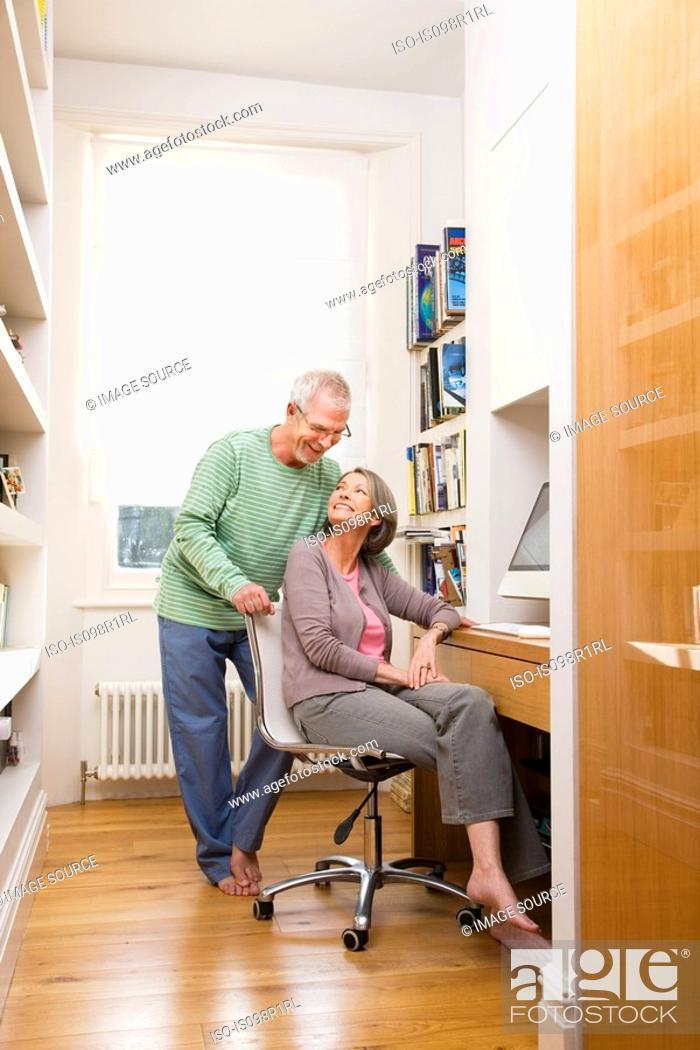 Stock Photo: Mature couple using a computer.