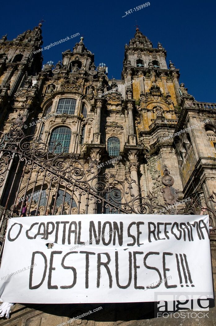 Stock Photo: Political banner in front of the cathedral in Santiago de Compostela during a political rally regarding austerity measures.
