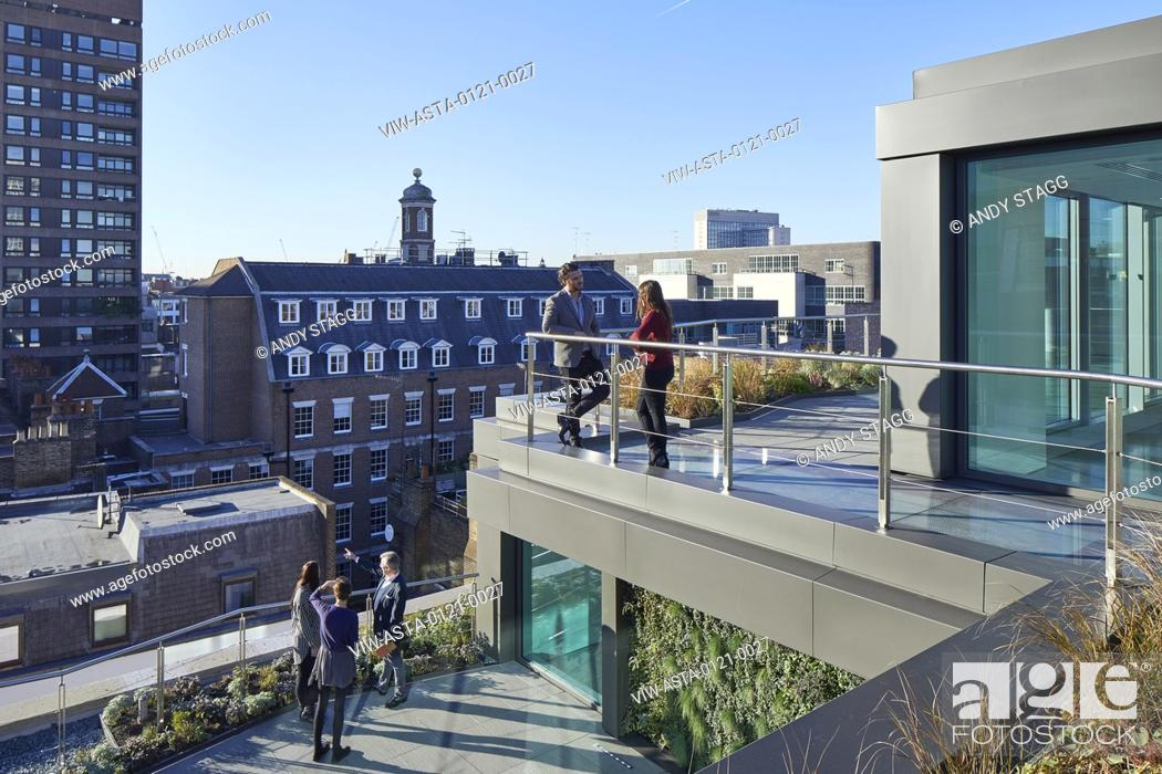 Stock Photo: Multi-level rooftop terrace with view over city. Thirty Broadwick, London, United Kingdom. Architect: Emrys Architects, 2016.