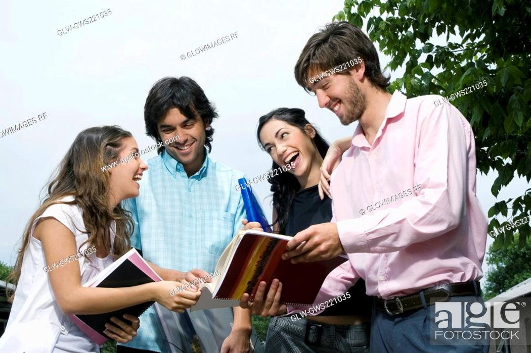 Stock Photo: University students discussing and smiling.