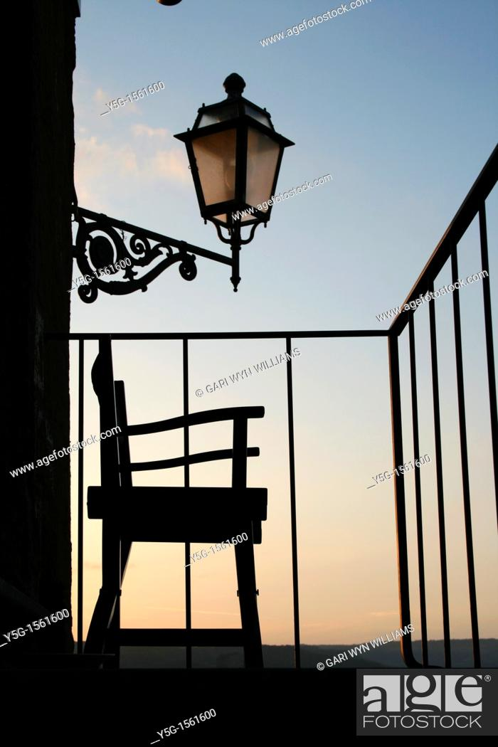 Stock Photo: one chair on balcony.