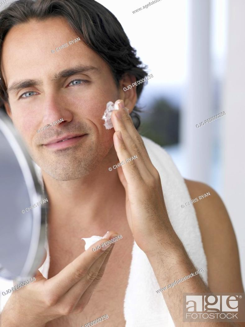 Stock Photo: Closeup of man shaving with mirror.
