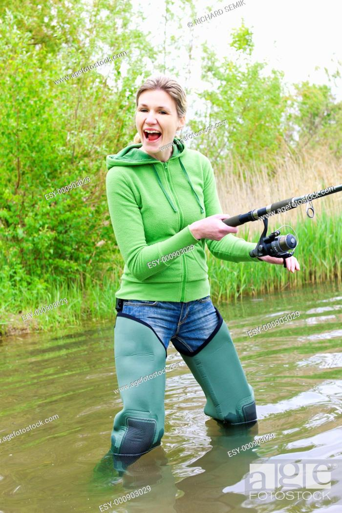 Stock Photo: woman fishing in pond.