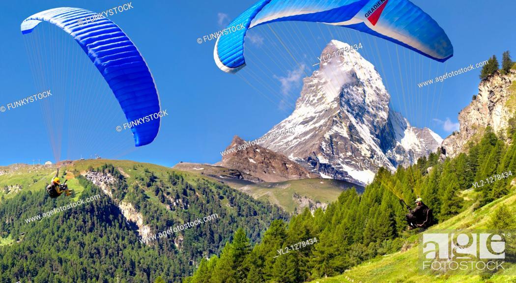 Stock Photo: Paragliders over the Matterhorn mountain peak - Swiss Alps - Switzerland.