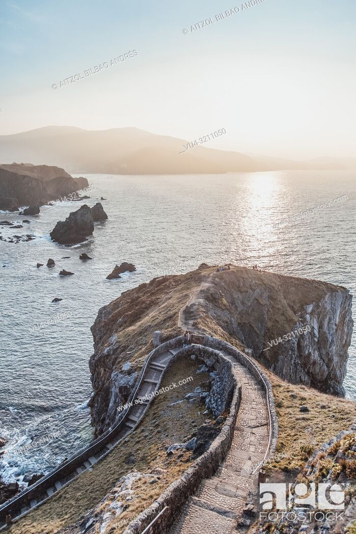 Stock Photo: Epic sunset at San Juan de Gaztelugatxe, this is a scenary from Game of thrones, the place in the tv show is called dragon stone.