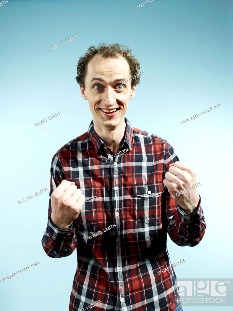 Stock Photo: A man with his hands clenched in fists in success.