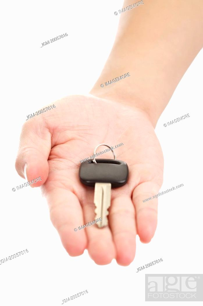 Stock Photo: Human hand giving a key.