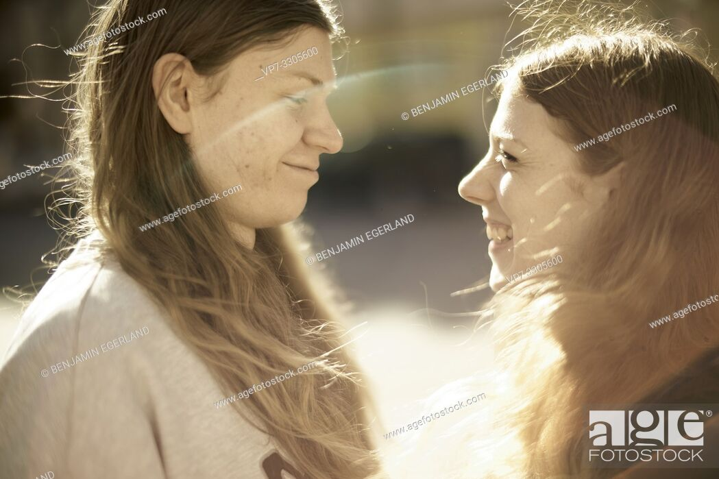 Stock Photo: couple outdoors in sunlight, in Berlin, Germany.