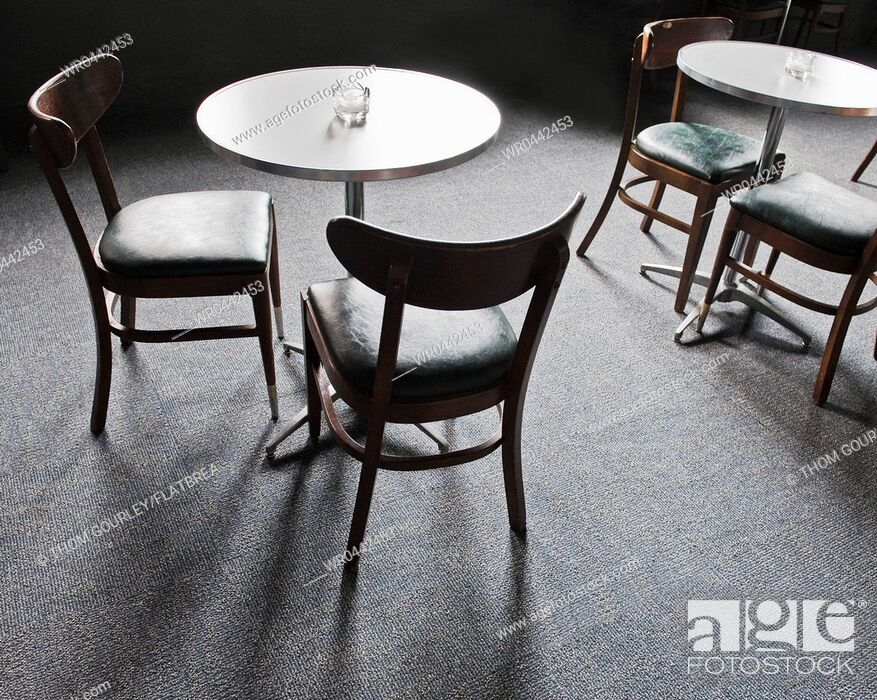 Imagen: Tables and Chairs in a Cafe.