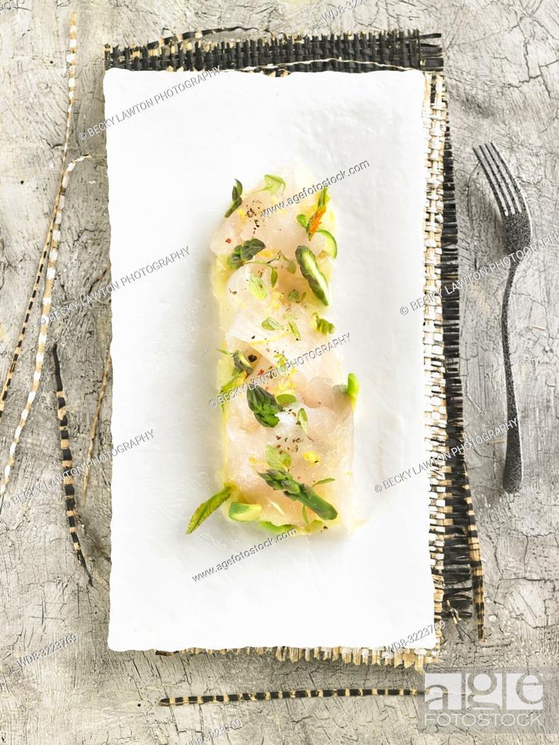 Stock Photo: lubina en escabeche de citricos / Citrus pickled sea bass.